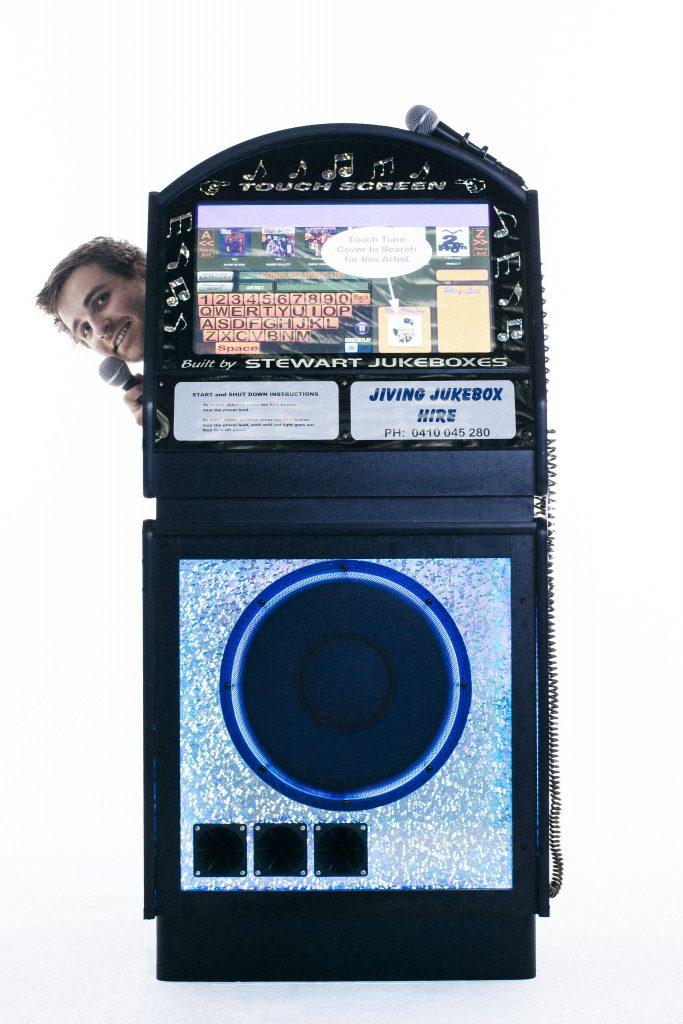 glenn poking behind the jukebox